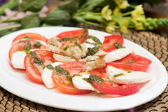 Plate of tomato and curd, cheese. Sliced. Italian cuisine. Appetizer Stock Photo