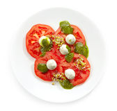 Plate of tomato and goat cheese balls salad Stock Image