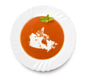 Plate tomato soup with cream in the shape of Canada.(series) Stock Photo