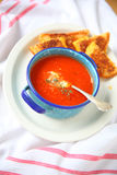 Plate with tomato soup and grilled cheese Royalty Free Stock Image