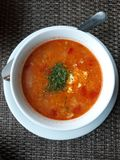A plate with tomato soup. Homemade kitchen. A plate with tomato soup. Dinner stock photo