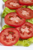 Plate of tomatoes on lettuce. Stock Photo
