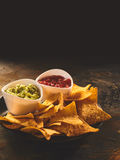 Plate of tortilla chips, guacamole and salsa dip Royalty Free Stock Image