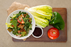 Plate of traditional Arabic salad fattouch on a wooden plate Royalty Free Stock Photo