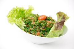 Plate of traditional Arabic salad tabbouleh. Royalty Free Stock Photography
