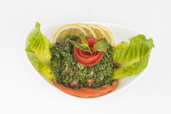 Plate of traditional Arabic salad tabbouleh. Isolated Stock Image