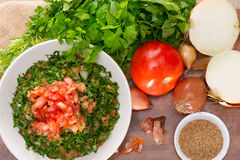 Plate of traditional Arabic salad tabbouleh on a wooden plate Royalty Free Stock Photos