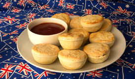 Plate of Traditional Australian Meat Pies And Tomato Sauce. Stock Photos