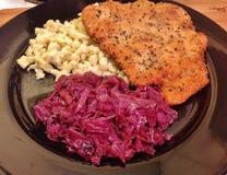 Pork schnitzel, spaezel and cabbage royalty free stock image