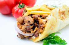 Plate of traditional Greek pita gyros with meat, fried potatoes, Royalty Free Stock Photos