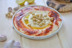 Plate of Traditional homemade hummus stock photo