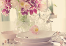 Plate and tulips decoration Stock Photos