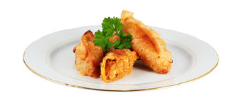Plate of tuna patties. Dish of homemade empanadas stuffed with tuna cut off and isolated Royalty Free Stock Images