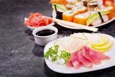 Plate of tuna sashimi. On dark background royalty free stock photography