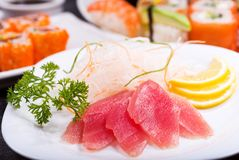 Plate of tuna sashimi. On dark background stock photo