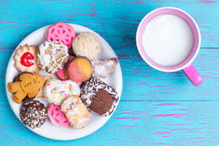 Plate with various cookies and milk Stock Photography