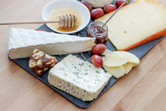 Plate with various french cheeses Royalty Free Stock Image