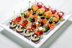 Plate with various seafood and meat canapes Stock Photo