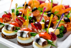 Plate with various seafood and meat canapes Royalty Free Stock Image