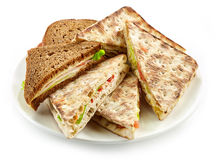 Plate of various triangle sandwiches Royalty Free Stock Photos