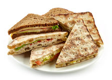 Plate of various triangle sandwiches Stock Image
