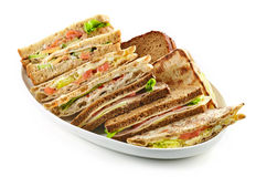Plate of various triangle sandwiches Royalty Free Stock Image