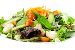 Plate of vegetable salad on white Stock Photo