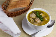 Plate of vegetable soup with meatballs. A plate of vegetable soup with meatballs on a white plate with bread Stock Photo