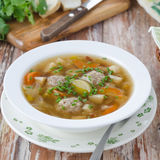 Plate of vegetable soup with meatballs on the wooden table Royalty Free Stock Photos