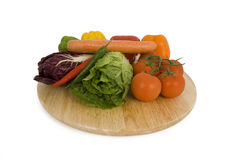 A plate with vegetables. Different vegetables are located on a plate Royalty Free Stock Image