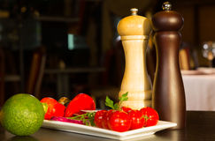 Plate of vegetables with condiments Royalty Free Stock Images