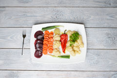 Plate with Vegetables and Fork Stock Photos