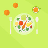 Plate with vegetables fruits and glass of juice on a table. Vegetarian food concept Stock Photography