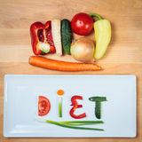 Plate with vegetables and word diet Stock Photography