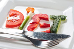 Plate with vegetables and word diet Stock Images