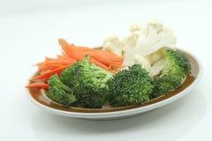 Plate of veggies. Plate of cut carrots, brocolli, cauli-flower Royalty Free Stock Photo