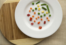 Plate of very few vegetables. Dieting concept Royalty Free Stock Images
