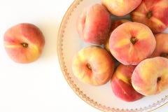 Plate of vine peaches Stock Image
