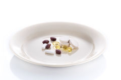 Plate with vitamin pills Stock Photos