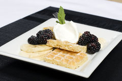 Plate of waffles bananas and blackberries Stock Photo
