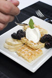 Plate of waffles bananas and blackberries Stock Images