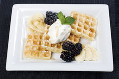Plate of waffles bananas and blackberries Royalty Free Stock Image