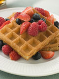 Plate Of Waffles With Berries And Maple Syrup Stock Photos