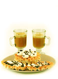 Plate with waffles and cups with cappuccino Stock Photos