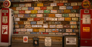 Plate wall. A wall with the typical american license plates in a old petrol station Stock Photo