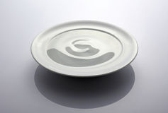 Plate with water Stock Images