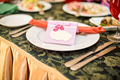 Plate on the wedding table with the guest's name. For text Royalty Free Stock Images