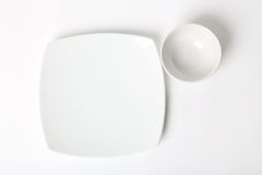 Plate. On white background. Square and circle plate on white background Royalty Free Stock Photo