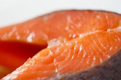 Fish trout - red delicious meat lies on a plate royalty free stock images
