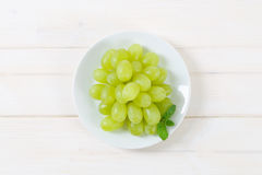 Plate of white grapes. On white background stock images